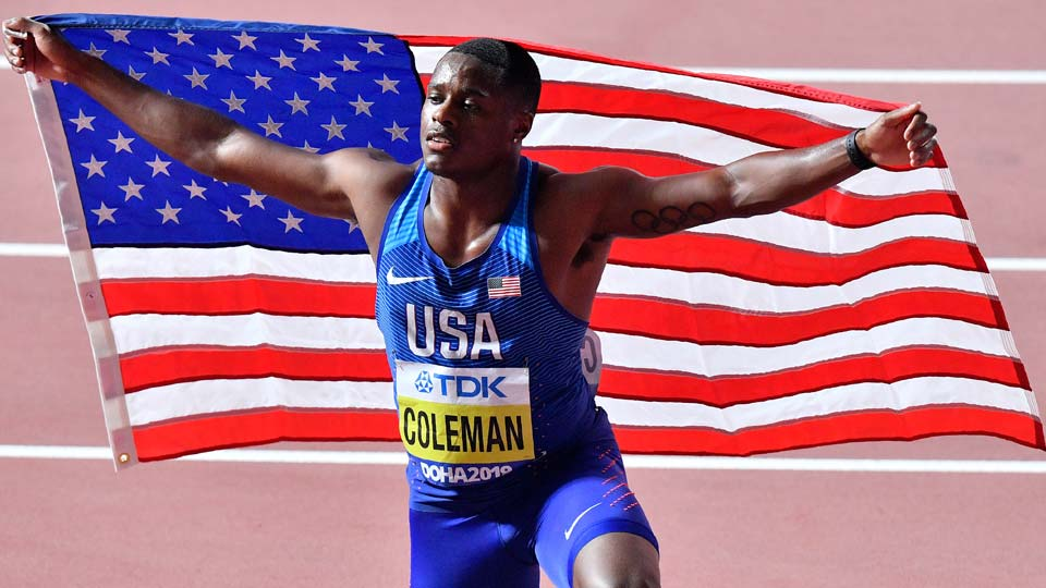 Christian Coleman, of the United States, poses after winning the men's 100 meter race during the World Athletics Championships