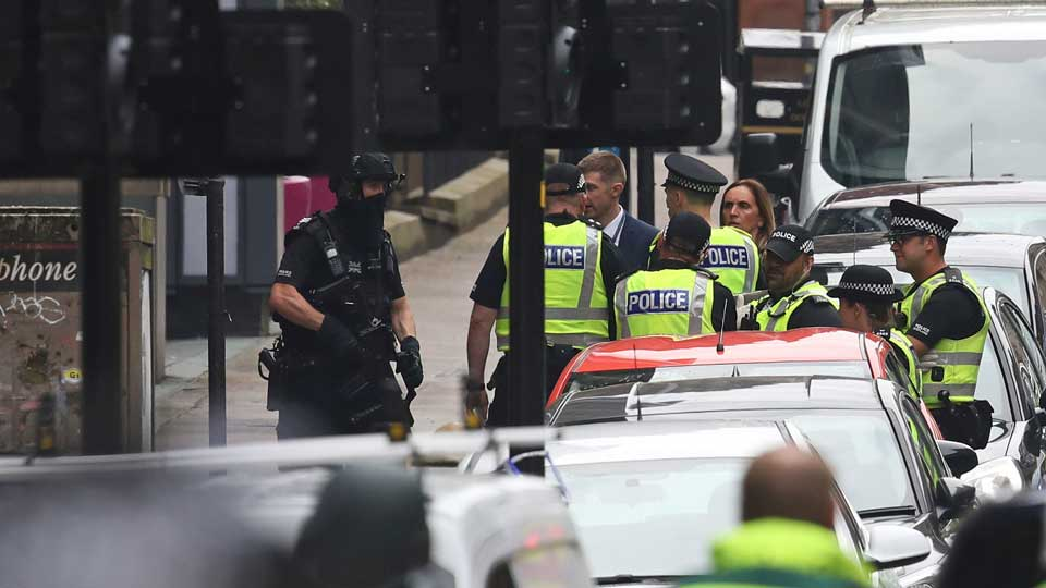 Armed police at the scene of an incident in Glasgow, Scotland, Friday June 26, 2020