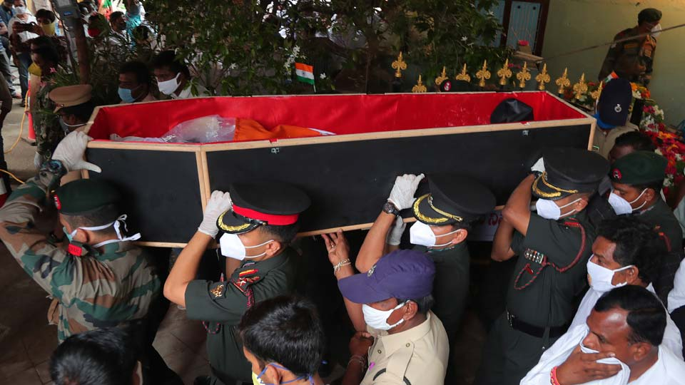 Indian army officers carry the coffin of Colonel B. Santosh Babu for his funeral in Suryapet