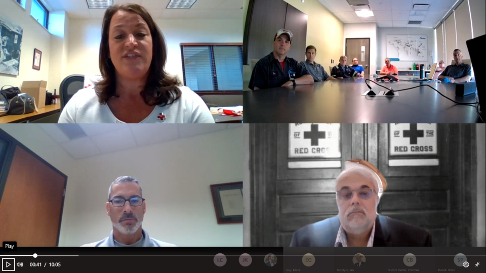 Video call from Red Cross awarding Nordson workers after saving life.