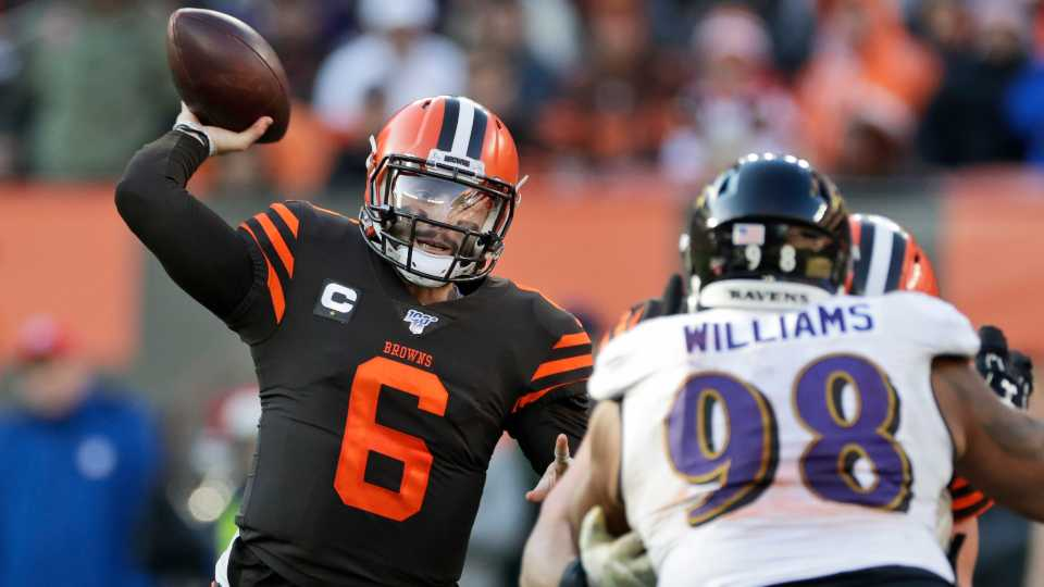 In this Sunday, Dec. 22, 2019 file photo, Cleveland Browns quarterback Baker Mayfield (6) passes against the Baltimore Ravens during the second half of an NFL football game in Cleveland. Cleveland Browns quarterback Baker Mayfield plans to kneel during the national anthem this upcoming season to support protests of social injustice, police brutality and racism, Saturday, June 13, 2020.
