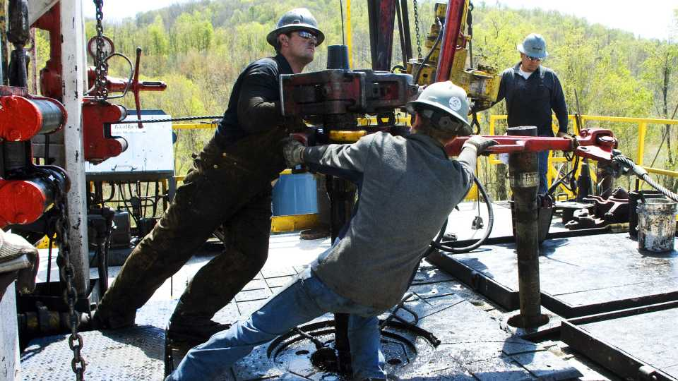 FILE - In this April 23, 2010, file photo, workers move a section of well casing into place at a Chesapeake Energy natural gas well site near Burlington, Pa., in Bradford County. Chesapeake Energy Corp. reports earnings, Thursday, May 4, 2017.
