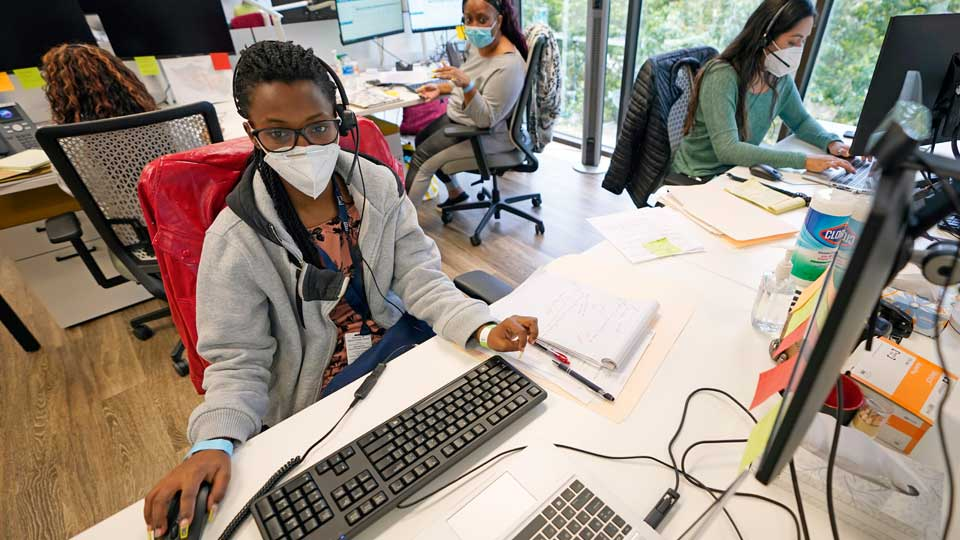 Contact tracers, from left to right, Christella Uwera, Dishell Freeman and Alejandra Camarillo work at Harris County Public Health contact tracing facility Thursday, June 25, 2020