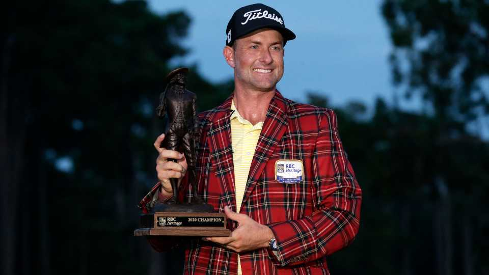 Webb Simpson holds the championship trophy after winning the RBC Heritage golf tournament, Sunday, June 21, 2020, in Hilton Head Island, S.C.