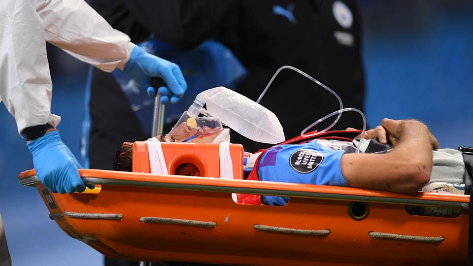 Manchester City's Eric Garcia leaves the field injured during the English Premier League soccer match between Manchester City and Arsenal