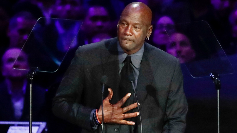 Former NBA player Michael Jordan reacts while speaking during a celebration of life for Kobe Bryant and his daughter Gianna in Los Angeles.