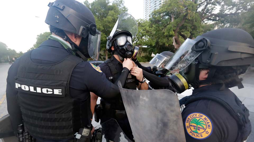 City of Miami police officers gear up as they prepare for any problems with protesters