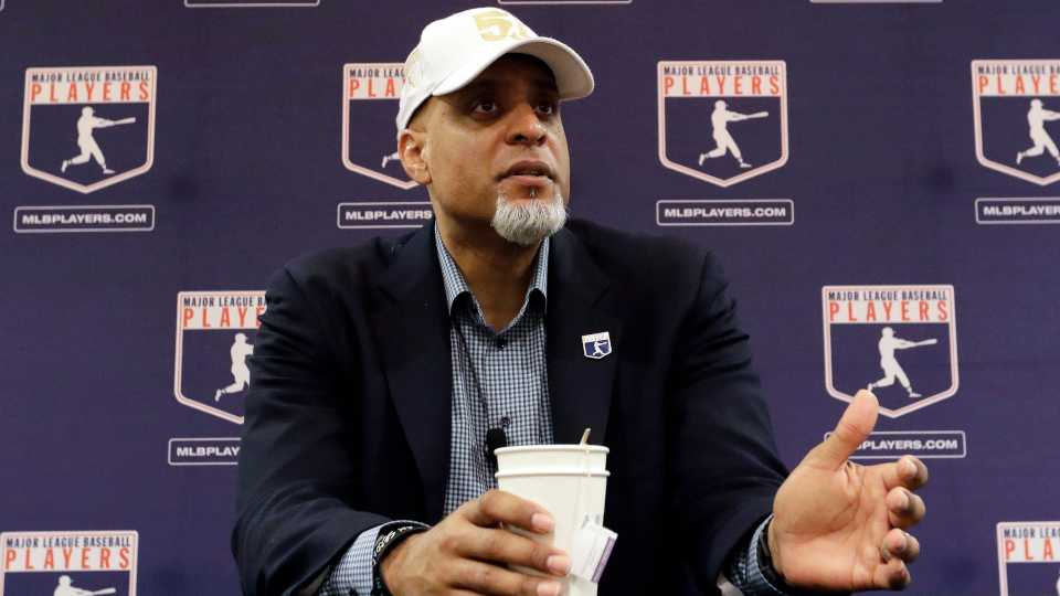 In this Feb. 19, 2017, file photo, Major League Players Association Executive Director Tony Clark, answers questions at a news conference in Phoenix. Commissioner Rob Manfred says there might be no major league season after a breakdown in talks between teams and the union on how to split up money in a season delayed by the coronavirus pandemic. The league also said several players have tested positive for COVID-19. Two days after union head Clark declared additional negotiations futile, Deputy Commissioner Dan Halem sent a seven-page letter to players' association chief negotiator Bruce Meyer asking the union whether it will waive the threat of legal action and tell MLB to announce a spring training report date and a regular season schedule.