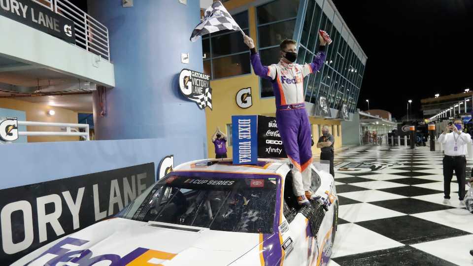 Denny Hamlin celebrates after winning a NASCAR Cup Series auto race Sunday, June 14, 2020, in Homestead, Fla.