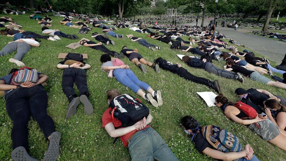 Demonstrators lie face down depicting George Floyd during his detention by police during a protest against police brutality