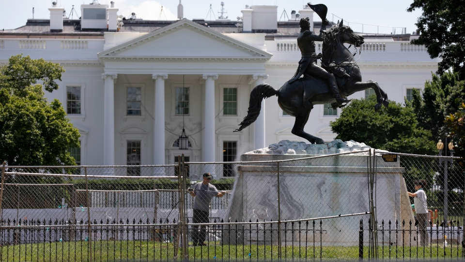 4 men charged in attack on Jackson statue near White House.
