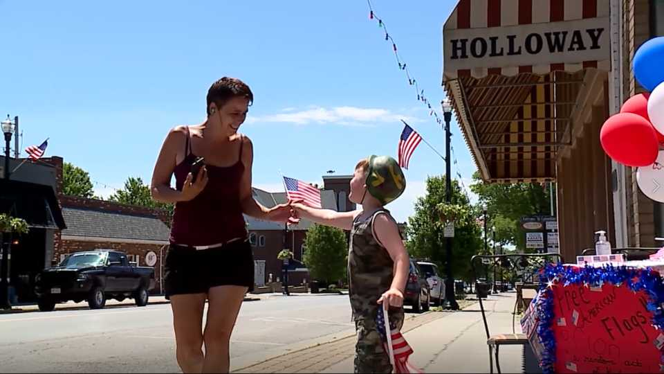 Salem boy American flag giveaway
