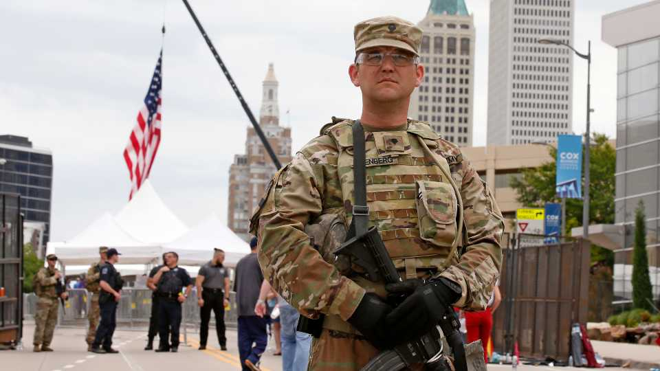 The National guard stands outside the BOK Center where President Trump will hold a rally in Tulsa, Okla., Saturday, June 20, 2020.
