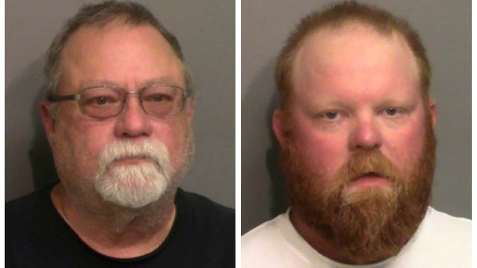 Photo combo of images provided by the Glynn County Detention Center in Georgia shows Gregory McMichael, left, and his son Travis McMichael