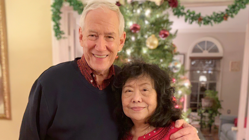 In this December, 2018 photo released by the Stemberger family, Victor and his wife Han Stemberger, are shown at their home in Centreville, Va.