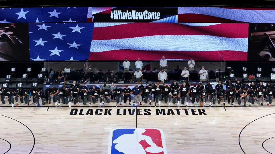 Players Coaches Kneel Before Nba S Re Opening Night Wkbn Com