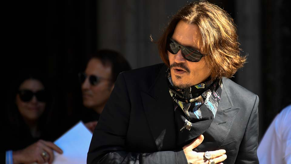 Actor Johnny Depp arrives at the High Court, in London, Monday July 20, 2020