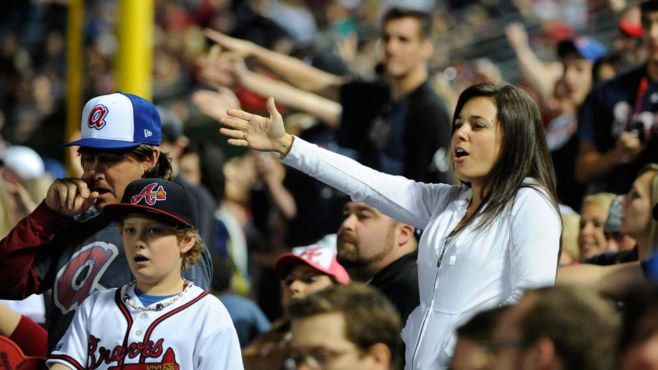 Atlanta Braves fans do the tomahawk chop during the ninth inning of a baseball game with the San Francisco Giants, in Atlanta