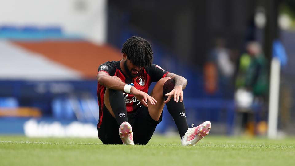 Bournemouth's Philip Billing sits on the pitch after their English Premier League soccer match
