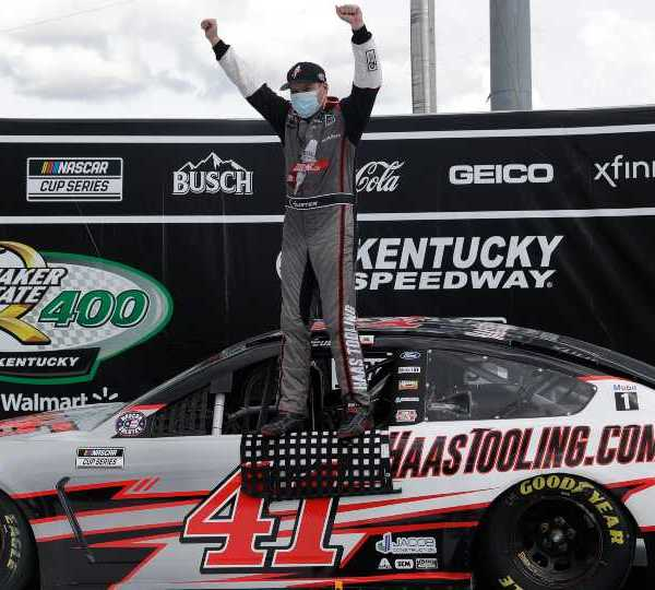 Cole Custer (41) celebrates after winning a NASCAR Cup Series auto race Sunday, July 12, 2020, in Sparta, Ky.
