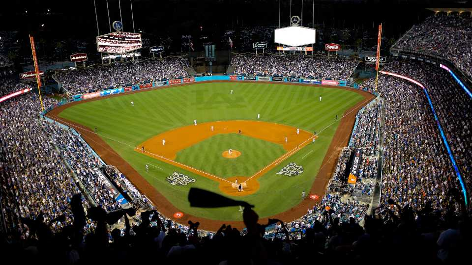 FILE - In this Oct. 25, 2017, file photo, the Houston Astros and the Los Angeles Dodgers play in Game 2 of the baseball World Series at Dodger Stadium in Los Angeles. Dodger Stadium's 40-year wait to host the All-Star Game is going to last even longer. The game scheduled for July 14 was canceled Friday, July 3, 2020, because of the coronavirus pandemic, and Dodger Stadium was awarded the 2022 Midsummer Classic.