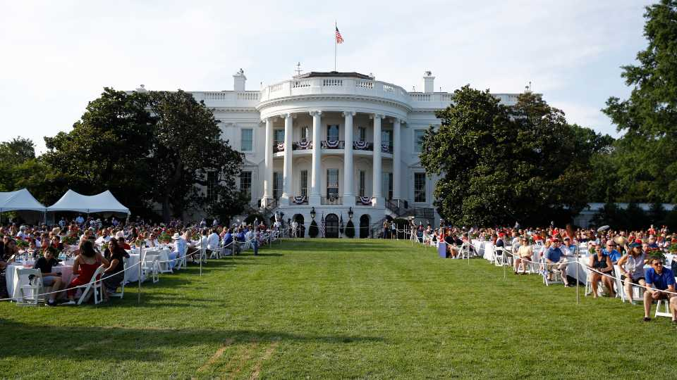 "Guests wait for President Donald Trump and first lady Melania Trump during a ""Salute to America"" event on the South Lawn of the White House, Saturday, July 4, 2020, in Washington."