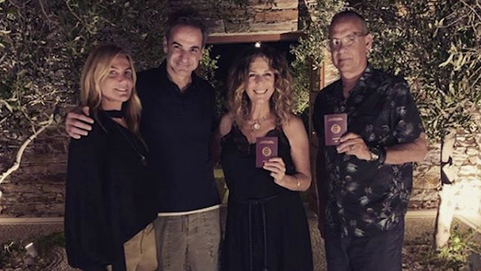 Greece's prime minister posted a picture on social media showing hanks and Wilson with their new passports.