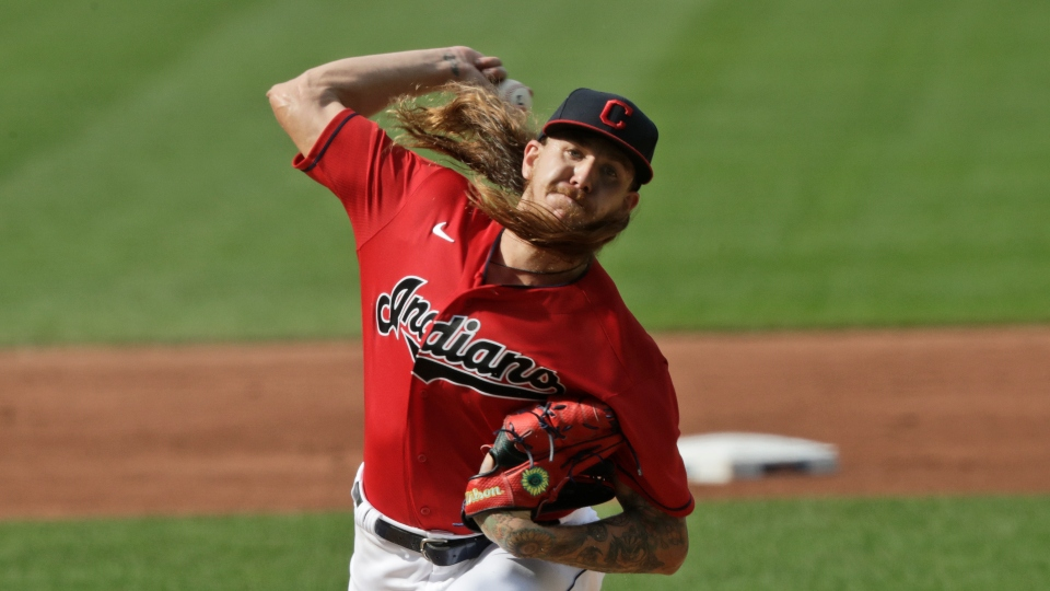 Cleveland Indians starting pitcher Mike Clevinger delivers in the first inning in a baseball game against the Kansas City Royals, Saturday, July 25, 2020, in Cleveland.