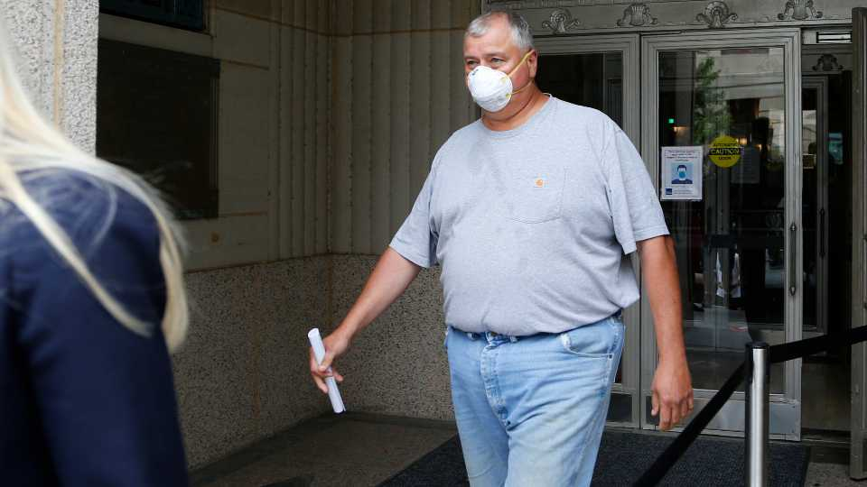 FILE - In this Tuesday, July 21, 2020, file photo, Ohio House Speaker Larry Householder leaves the federal courthouse after an initial hearing following charges against him and four others alleging a $60 million bribery scheme, in Columbus, Ohio.