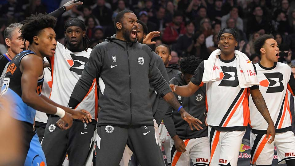 Members of the Los Angeles Clippers celebrate from the bench