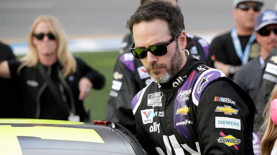 In this Feb. 16, 2020 file photo Jimmie Johnson climbs intp his car before the NASCAR Daytona 500 auto race at Daytona International Speedway in Daytona Beach, Fla.