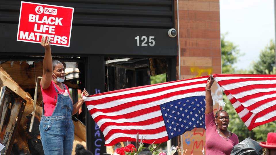 Protesters chant outside a Wendy's restaurant