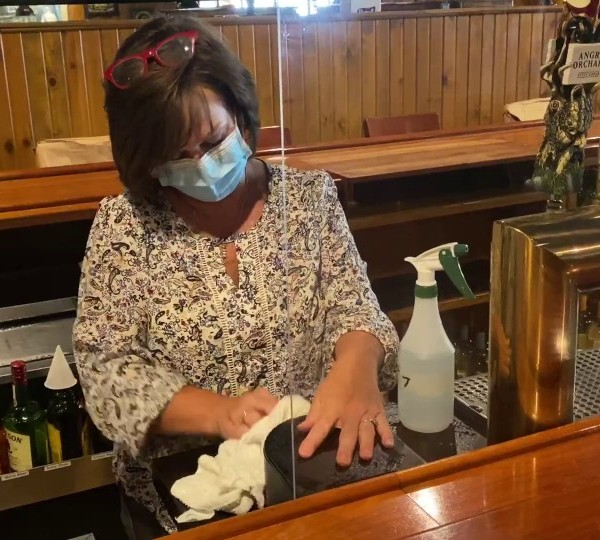 Owner cleaning Edward's Restaurant in New Castle