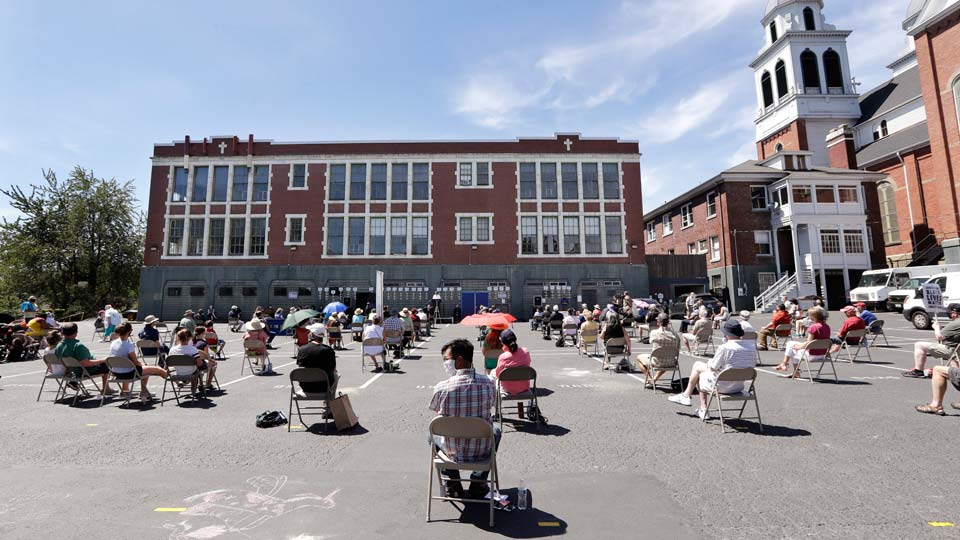 Church parishioners sit apart at a prayer vigil for racial justice at Immaculate Conception Catholic Church Sunday, July 19, 2020, in Seattle