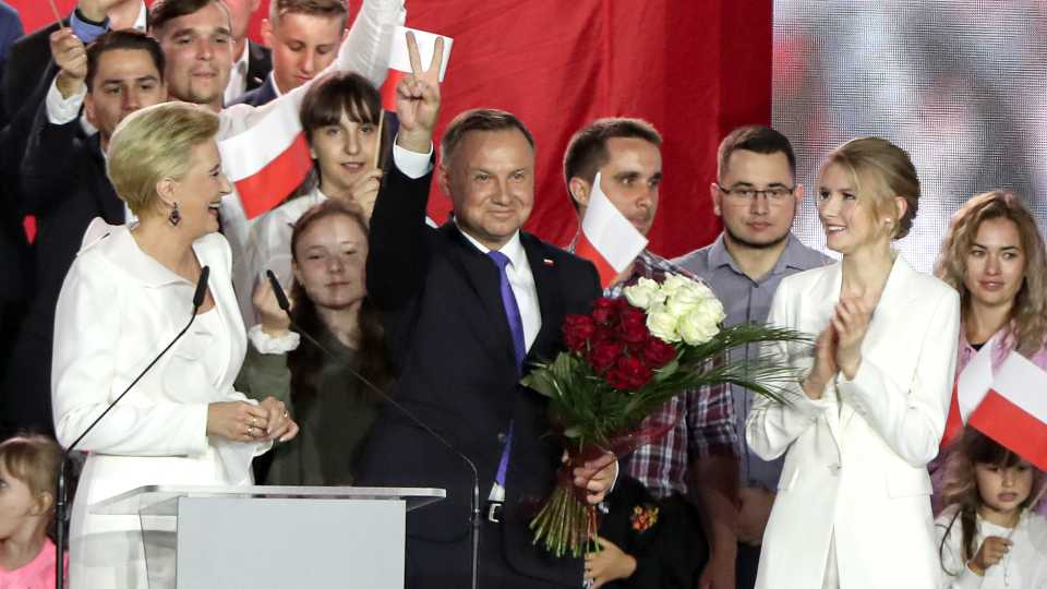 Incumbent President Andrzej Duda flashes a victory sign in Pultusk, Poland, Sunday, July 12, 2020. An exit poll in Poland's presidential runoff election shows a tight race that is too close to call between the conservative incumbent, Andrzej Duda, and the liberal Warsaw mayor, Rafal Trzaskowski.