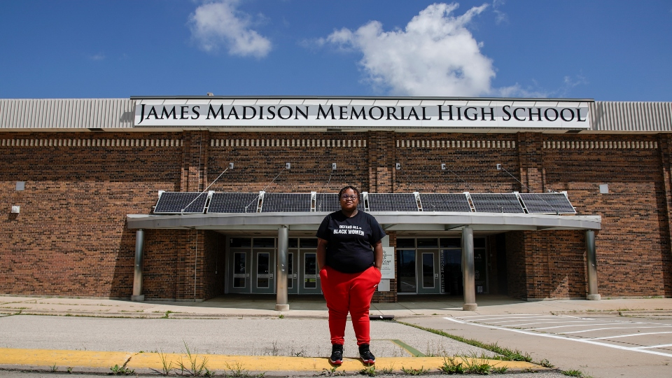 Shyra Adams stands outside James Madison Memorial High School Friday, July 17, 2020,in Madison, Wis.