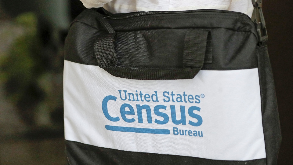 A briefcase of a census taker is seen as she knocks on the door of a residence Tuesday, Aug. 11, 2020, in Winter Park, Fla.