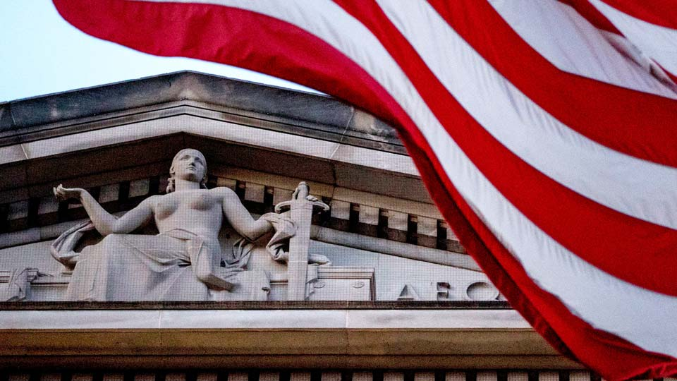 American flag flies outside the Department of Justice in Washington