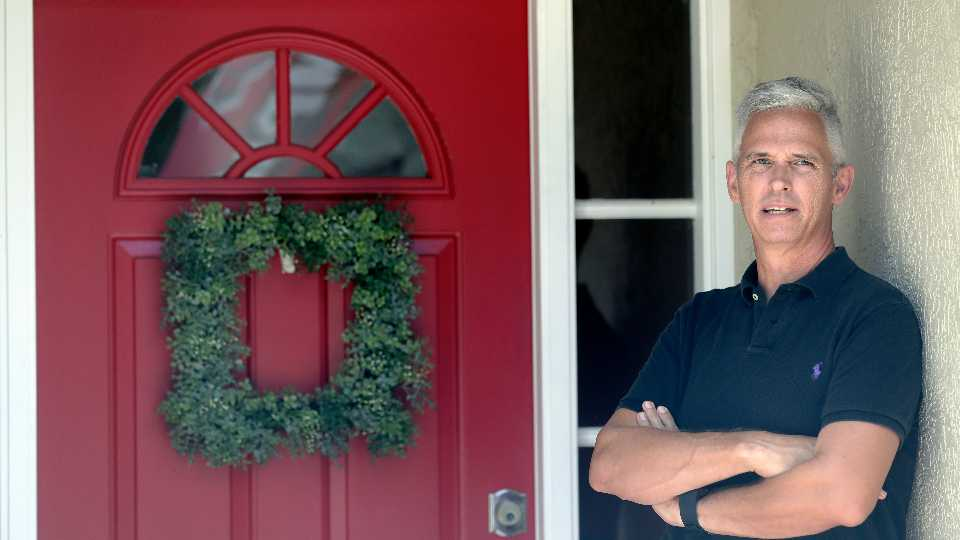 Bob Garick stands by the entrance to his home Wednesday, Aug. 5, 2020, in Oviedo, Fla. Garick was looking forward to being a field supervisor during the door-knocking phase of the 2020 census, but as the number of new coronavirus cases in Florida shot up last month, he changed his mind and decided not to take the job