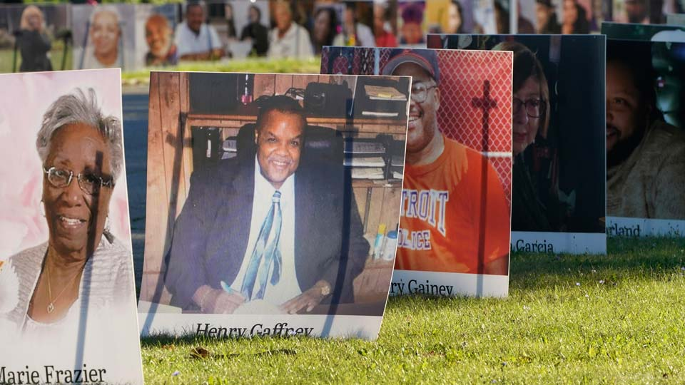 Some of the nearly 900 large poster-sized photos of Detroit victims of COVID-19 are displayed, Monday, Aug. 31, 2020 on Belle Isle in Detroit