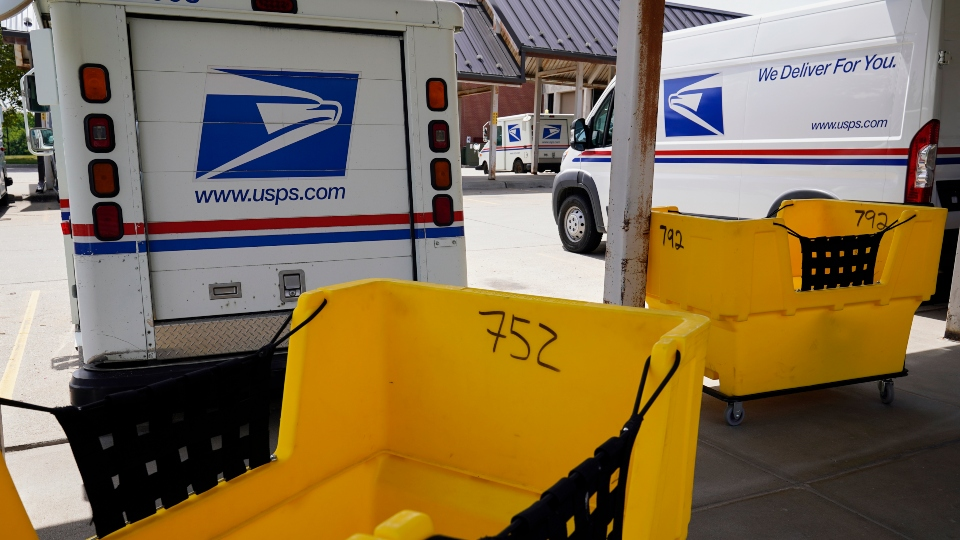 ail delivery vehicles are parked outside a post office in Boys Town, Neb., Tuesday, Aug. 18, 2020.