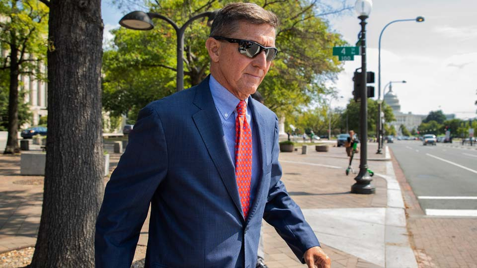 Michael Flynn, President Donald Trump's former national security adviser, leaves the federal court following a status conference in Washington