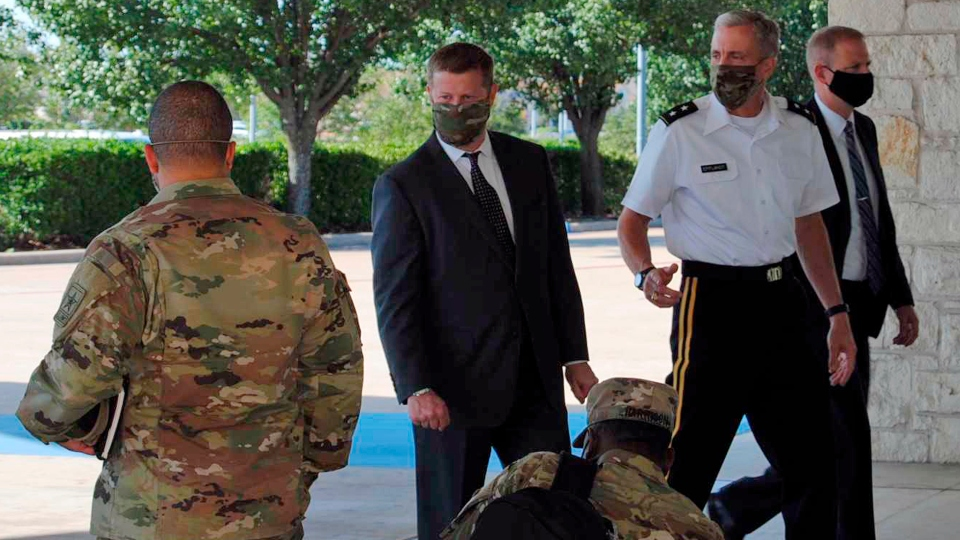 Secretary of the Army Ryan McCarthy, center, into the Killeen Civic and Conference Center Thursday morning, Aug. 6, 2020, ahead of a meeting with local officials in Killeen, Texas.