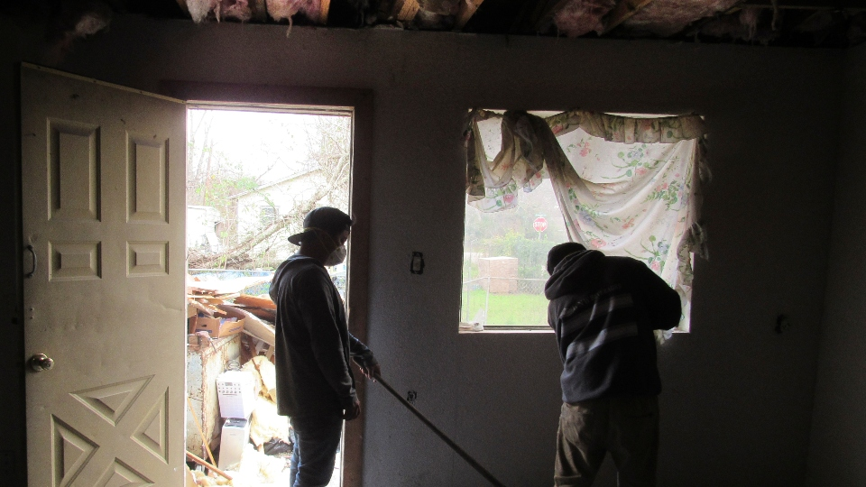 Construction workers continue Friday, January 31, 2020, repairing and cleaning up the Hurricane Harvey damaged home of Houston resident Lawrence Hester.