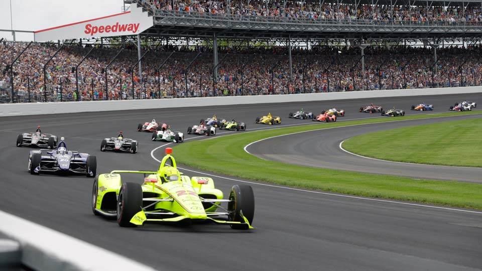 Simon Pagenaud, of France, leads the field through the first turn on the start of the Indianapolis 500 IndyCar auto race at Indianapolis Motor Speedway