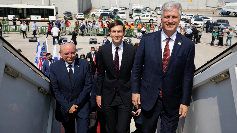 Israeli National Security Advisor Meir Ben-Shabbat, left, U.S. President Donald Trump's senior adviser Jared Kushner, center, and U.S. National Security Advisor Robert O'Brien, right, board the Israeli flag carrier El Al's airliner as they fly to Abu Dhabi for talks meant to put final touches on the normalization deal between the United Arab Emirates and Israel