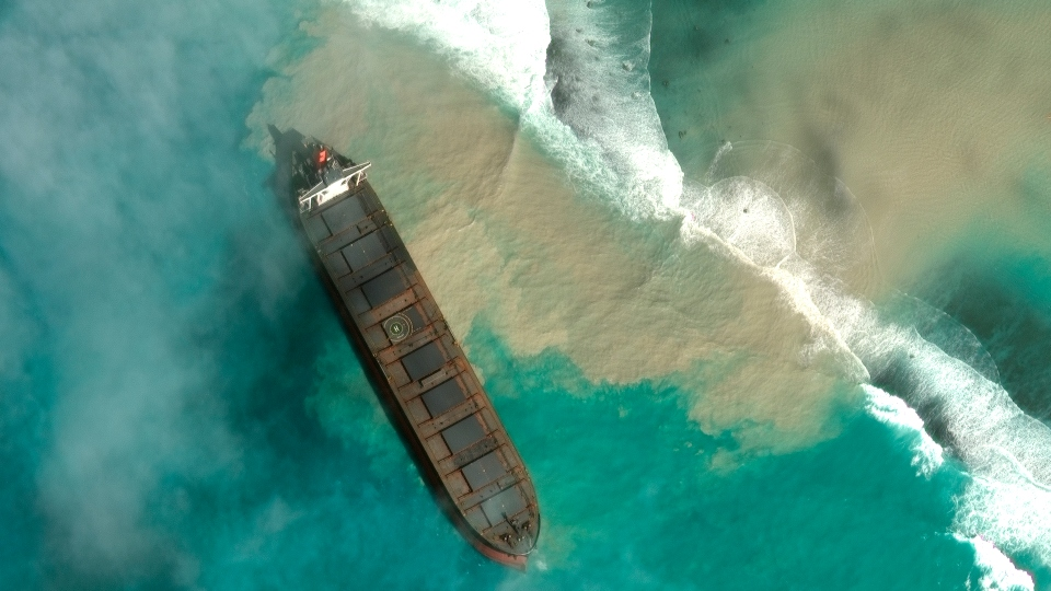 In this satellite image provided by 2020 Maxar Technologies on Friday, Aug. 7, 2020, an aerial view of the MV Wakashio, a bulk carrier ship that recently ran aground off the southeast coast of Mauritius.