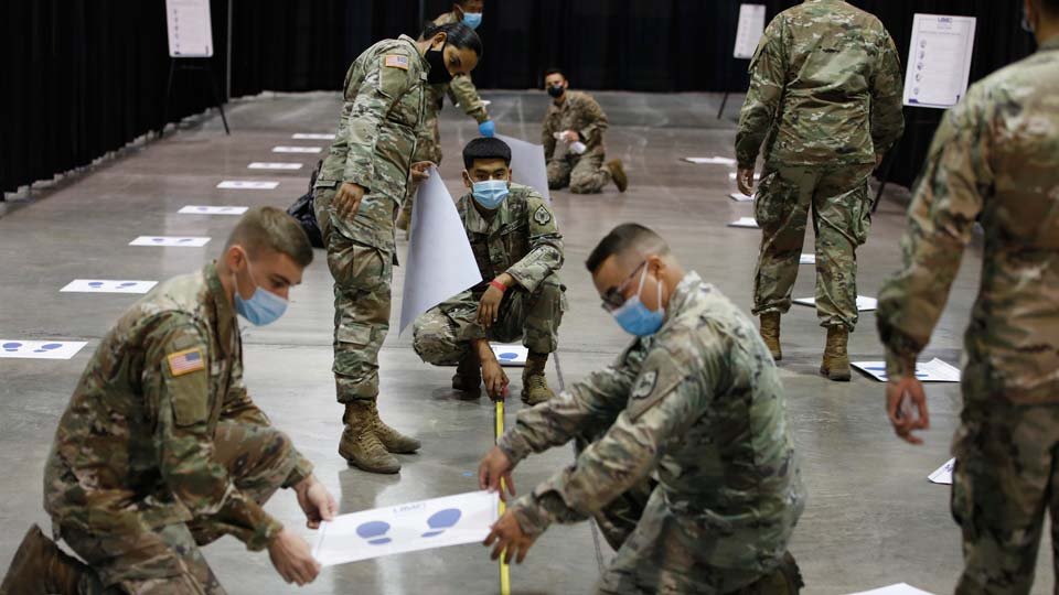 Members of the Nevada National Guard install social distancing stickers