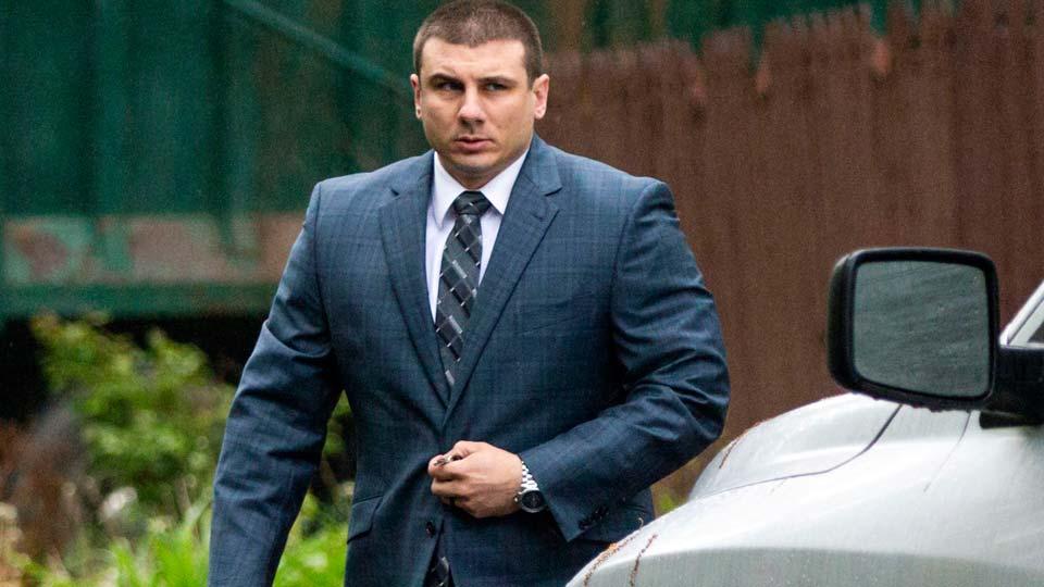 New York City police officer Daniel Pantaleo leaves his house in Staten Island, N.Y.