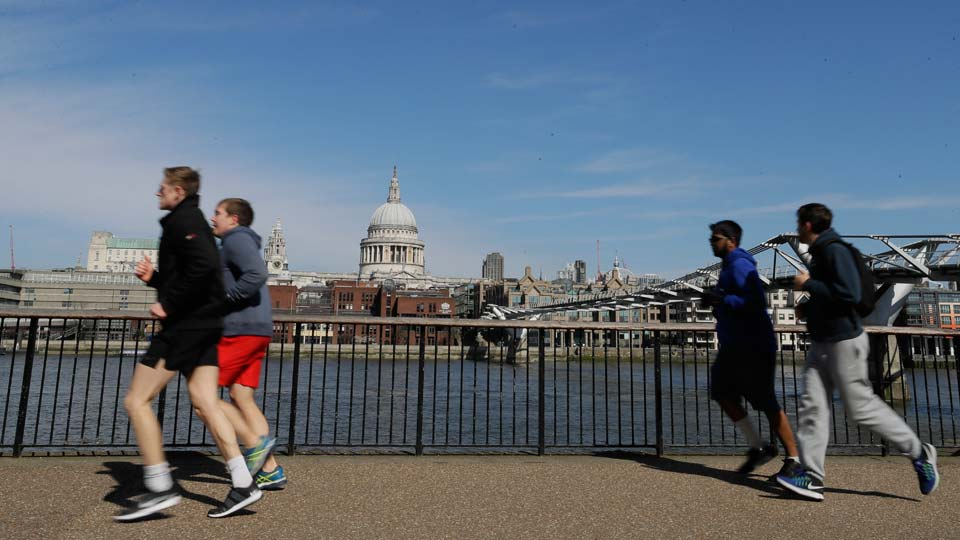 People run to keep fit along the south bank of the River Thames in London